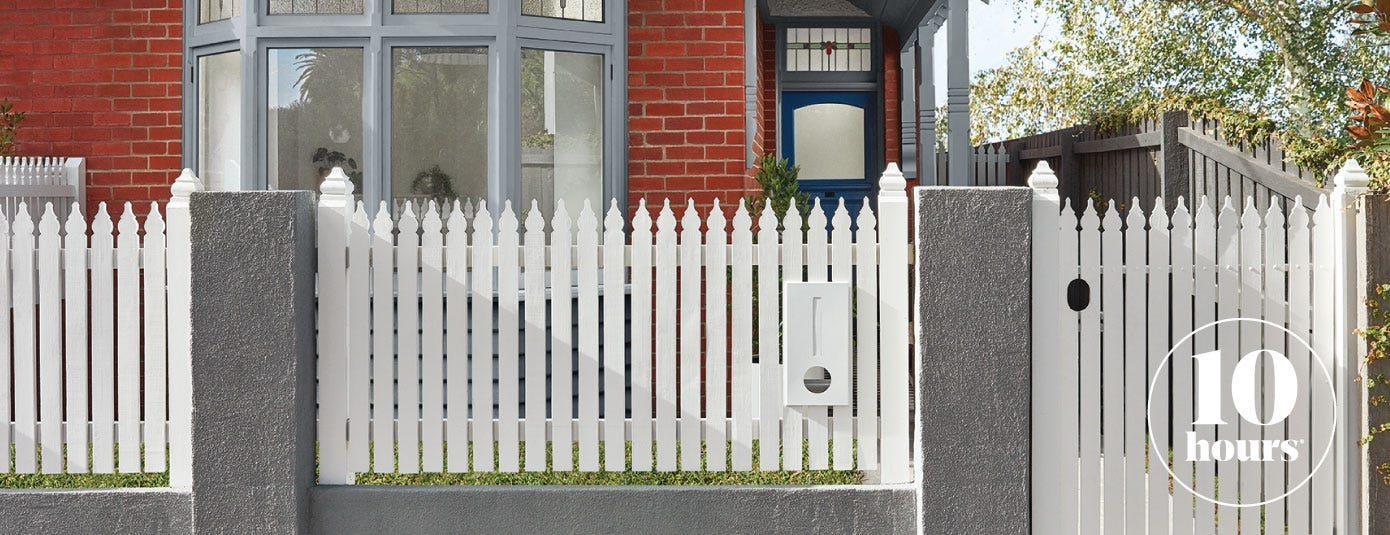 a newly painted picked fence