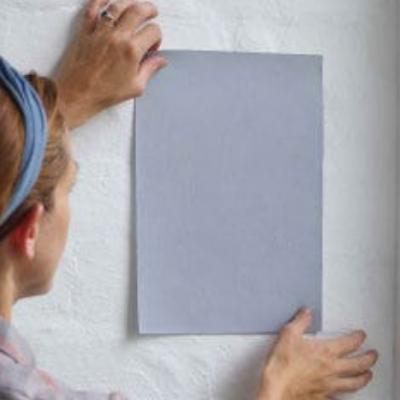 Woman using paint sample